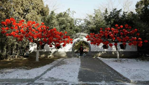 Chinese people decorate Ditan park to greet the New Year on February 6, 2013 in Beijing, China. Falling on February 10 this year, the Chinese Lunar New Year, also known as the Spring Festival, which is based on the Lunisolar Chinese calendar, is celebrated from the first day of the first month of the lunar year and ends with Lantern Festival on the Fifteenth day. Photo: Lintao Zhang, Getty Images / 2013 Getty Images