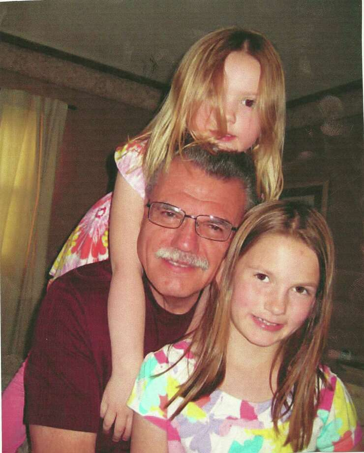 Emily and Abbey Wood, grandchildren of Frank and Judy Wood of Niverville, spend a little uplifting time with their grandfather, who they call Poppi.  (Judy Wood)