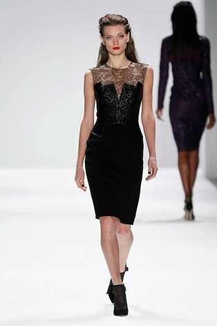 A model walks the runway at the Carmen Marc Valvo Fall 2013 fashion show during Mercedes-Benz Fashion Week at The Stage at Lincoln Center on February 8, 2013 in New York City. Photo: Peter Michael Dills, Getty Images / 2013 Getty Images