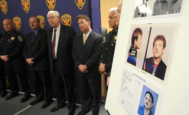"Police officers line up behind pictures of Dan Therrien during a press conference about Kevin Collins' 1984 disappearanceon Wednesday, Feb. 6, 2013, in San Francisco. Police named Therrien, who died in 2008, as a ""person of interest"" in the decades-old case. Photo: Noah Berger, Special To The Chronicle"
