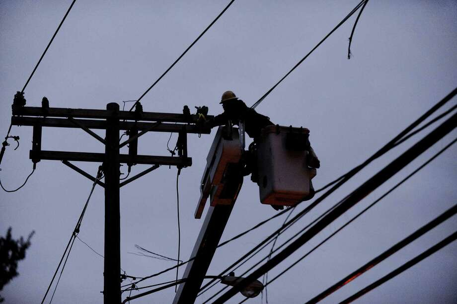 Connecticut Light and Power crews work to repair wires on Newfield Avenue between Case Road and Denicola Place in Stamford, Conn. on Wednesday, Oct. 31, 2012. Crews worked into the night in an effort to restore power to residents after severe damage from the effects of Hurricane Sandy left many in the city in the dark. (Cathy Zuraw / Stamford Advocate) Photo: Cathy Zuraw / Stamford Advocate