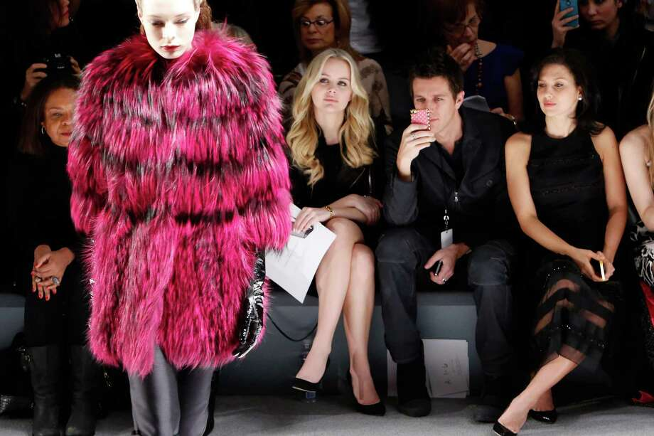 Actors Helena Mattsson and Ella Rae Peck attend the Carmen Marc Valvo Fall 2013 fashion show during Mercedes-Benz Fashion Week at The Stage at Lincoln Center on February 8, 2013 in New York City. Photo: Cindy Ord, Getty Images For Carmen Marc Valvo / 2013 Getty Images