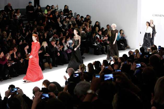 Models walk the runway at the Carmen Marc Valvo Fall 2013 fashion show during Mercedes-Benz Fashion Week at The Stage at Lincoln Center on February 8, 2013 in New York City. Photo: Cindy Ord, Getty Images For Carmen Marc Valvo / 2013 Getty Images
