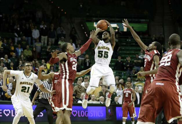 Baylor guard Pierre Jackson (right) stands out among his Big 12 peers despite his 5-foot-10 stature. He has a shot to become the first player to lead the conference in scoring and assists in the same season. Photo: Tony Gutierrez / Associated Press