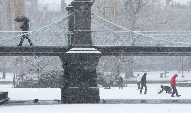 A man walks across a bridge in the snow in Boston Common on February 8, 2013 in Boston, Massachusetts. Massachusetts and other states from New York to Maine are preparing for a major blizzard with possible record amounts of snowfall in some areas. Photo: Mario Tama, Getty Images / 2013 Getty Images