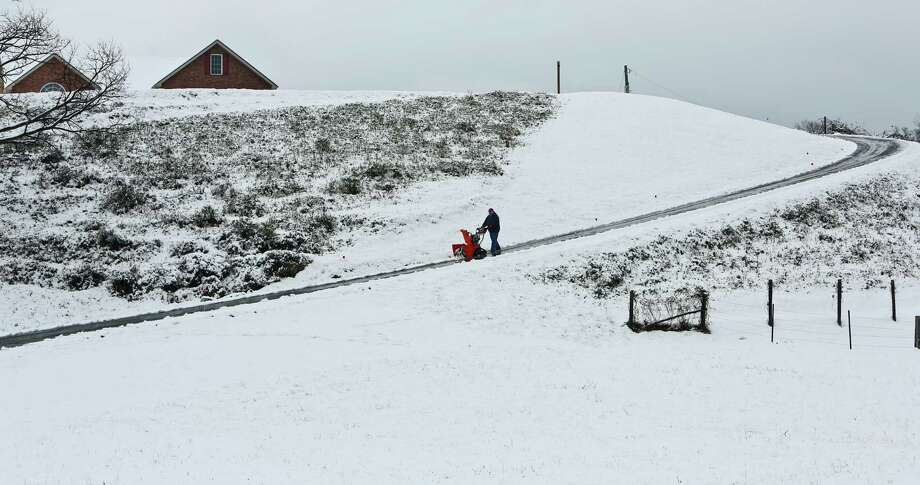 Fred White uses his snow blower for the fourth time in two years of ownership Friday, Feb. 8, 2013 in Salem, Va. Photo: Stephanie Klein-Davis, Associated Press / The Roanoke Times