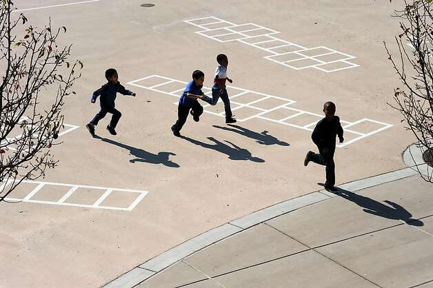 Students at King Elementary School in Richmond play on the light pavement that helps keep the schoolyard cool. Photo: Michael Short, Special To The Chronicle