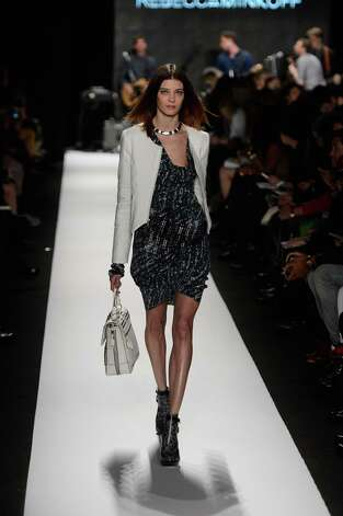 A model walks the runway at the Rebecca Minkoff Fall 2013 fashion show with TRESemme during Mercedes-Benz Fashion Week at The Theatre at Lincoln Center on February 8, 2013 in New York City. Photo: Frazer Harrison, Getty Images For TRESemme / Getty Images