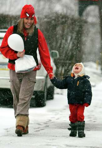 Jet Traver, 3, tries to catch snowflakes in his mouth as he walks with his mother Casey Traver, of Plains, along East Carey Street in Plains Township, Pa., Friday, February 8, 2013. Photo: Kristen Mullen, Associated Press / The Citizens' Voice