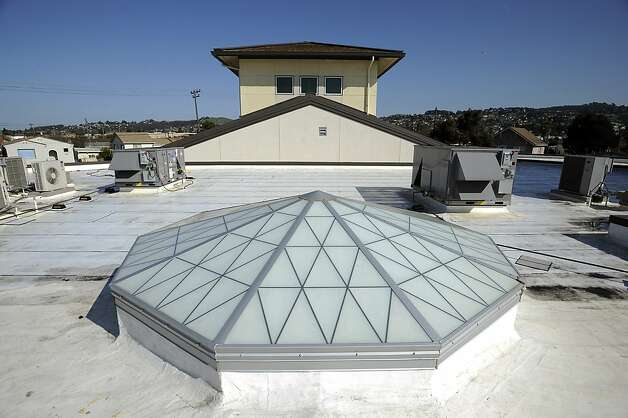 "A large energy efficient skylight and ""cool roofing"" is seen on the roof of the library at King Elementary School in Richmond, CA Wednesday February 6th, 2013.  ""Cool Roofs and Pavement"" are specifically made pavement and white roofs that reflect back more light and heat, using technology developed at Lawrence Berkeley Lab. Photo: Michael Short, Special To The Chronicle"