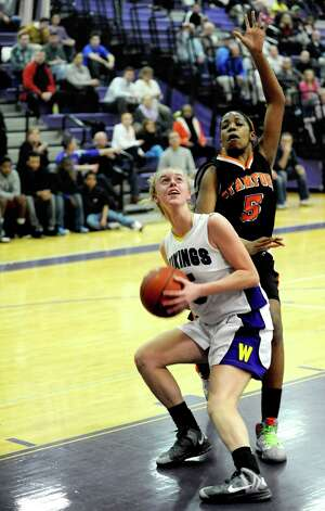 Westhill's Steph Roones takes a shot while guarded by Stamford's Ashyla Cody. Roones unselfish play at point guard has the Vikings riding a 13-game win streak. Photo: Lindsay Perry / Stamford Advocate