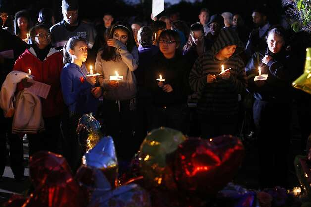 Mourners pay their respects at a candlelight vigil for Genelle Conway-Allen at Allan Witt Park in Fairfield on Friday, Feb. 8. Conway-Allen was found dead in the park a week ago. Photo: James Tensuan, The Chronicle