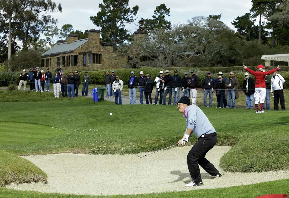 Fredrik Jacobson hits out of a bunker on the sixth hole during the second round of the Pebble Beach Pro-Am. Jacobson shot a 66, which put him at 7-under along with three others. Photo: Ben Margot / Associated Press
