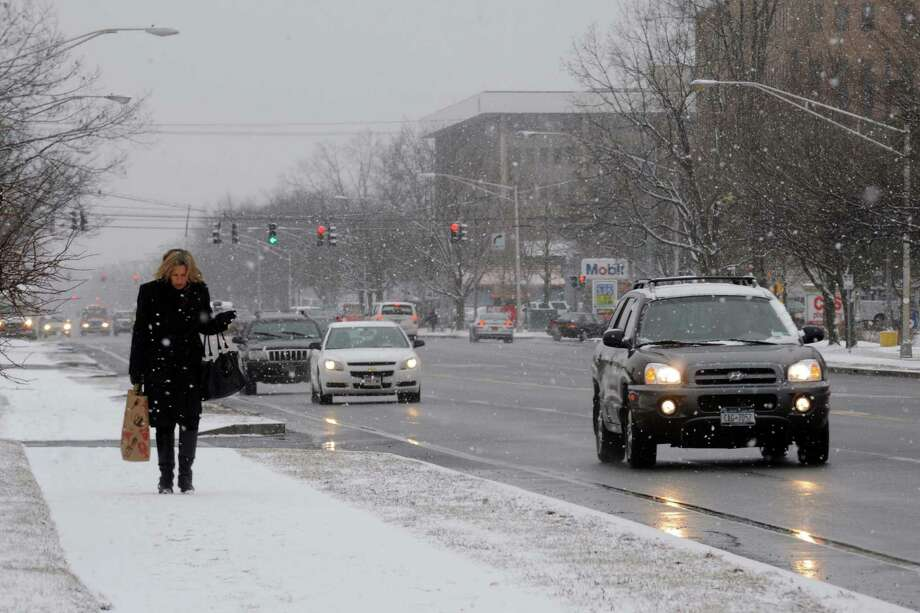 Catherine Willows of New Baltimore walks up Wolf Road during a light snow fall on Friday Feb. 8, 2013 in Colonie, N.Y. .(Michael P. Farrell/Times Union) Photo: Michael P. Farrell