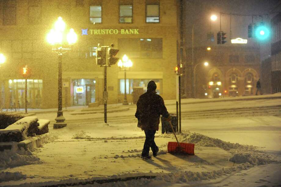 An employee shovels the sidewalk during a snowstorm on Friday, Feb. 8, 2013, at Hotel Albany in Albany, N.Y. (Cindy Schultz / Times Union) Photo: Cindy Schultz / 00021096A