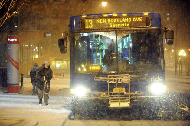 A CDTA bus stops to pick up passengers during a snowstorm on Friday, Feb. 8, 2013, in Albany, N.Y. (Cindy Schultz / Times Union) Photo: Cindy Schultz / 00021096A