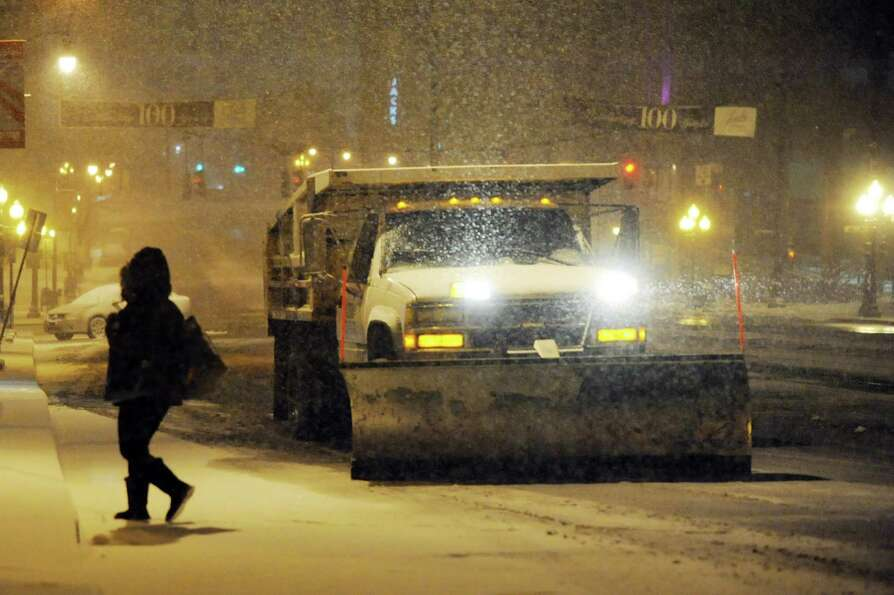 A plow truck drives up State Street during a snowstorm on Friday, Feb. 8, 2013, in Albany, N.Y. (Cin