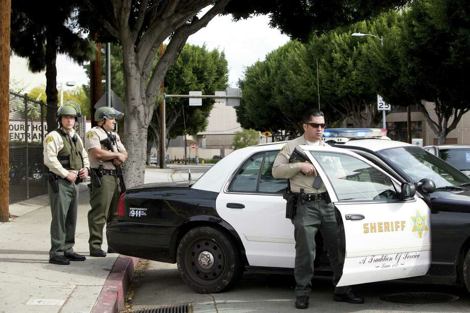 Sheriff's deputies are posted outside the Twin Towers Correctional Facility in Los Angeles during a lockdown after a reported sighting of Christopher Dorner. Photo: Monica Almeida / New York Times