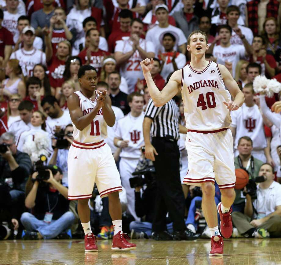 FILE - In this Sunday, Jan. 27, 2013 file photo, Indiana's Cody Zeller (40) and Yogi Ferrell (11) celebrate after defeating Michigan State 75-70 in an NCAA college basketball game in Bloomington, Ind. There are a wide range of title contenders in this college basketball season, including Indiana. (AP Photo/Darron Cummings, File) Photo: Darron Cummings