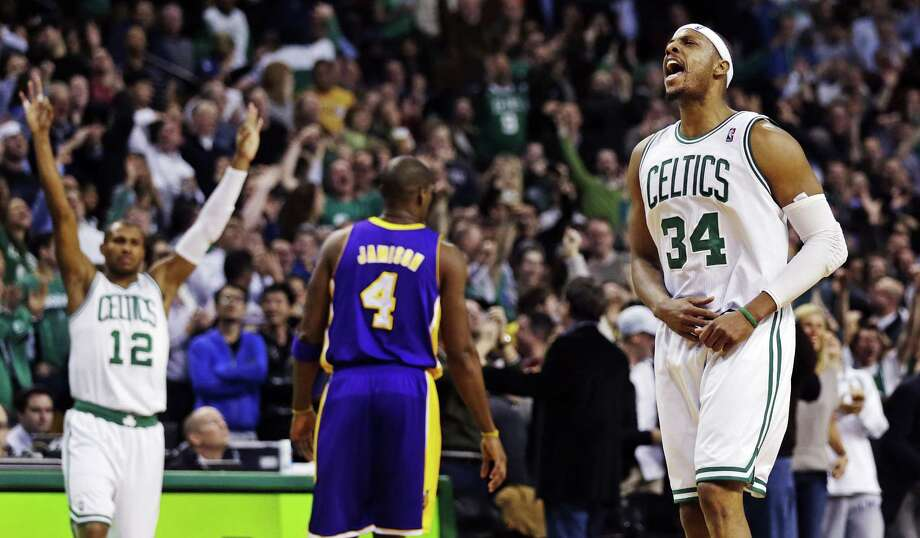 Boston Celtics forward Paul Pierce (34) celebrates a 3-pointer as guard Leandro Barbosa (12) reacts and Los Angeles Lakers forward Antawn Jamison (4) walks away during the fourth quarter of an NBA basketball game in Boston, Thursday, Feb. 7, 2013. Pierce scored 24 points as the Celtics won 116-95. (AP Photo/Charles Krupa) Photo: Charles Krupa