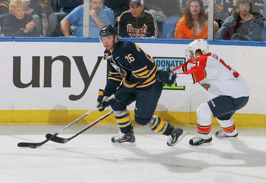 BUFFALO, NY - FEBRUARY 03: Thomas Vanek #26 of the Buffalo Sabres skates against Brian Campbell of the Florida Panthers at First Niagara Center on February 3, 2013 in Buffalo, New York. (Photo by Rick Stewart/Getty Images) Photo: Rick Stewart / 2013 Getty Images