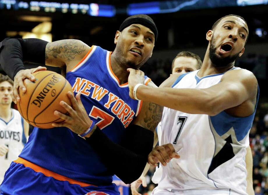 New York Knicks' Carmelo Anthony  drives around Minnesota Timberwolves' Derrick Williams in the second half of an NBA basketball game Friday, Feb. 8, 2013 in Minneapolis. The Knicks won 100-94. Anthony led the Knicks with 36 poiints and 9 rebounds. (AP Photo/Jim Mone) Photo: Jim Mone