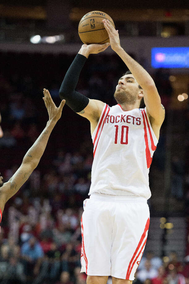 Rockets small forward Carlos Delfino (10) shoots a three-pointer. Photo: Smiley N. Pool, Houston Chronicle / © 2013  Houston Chronicle