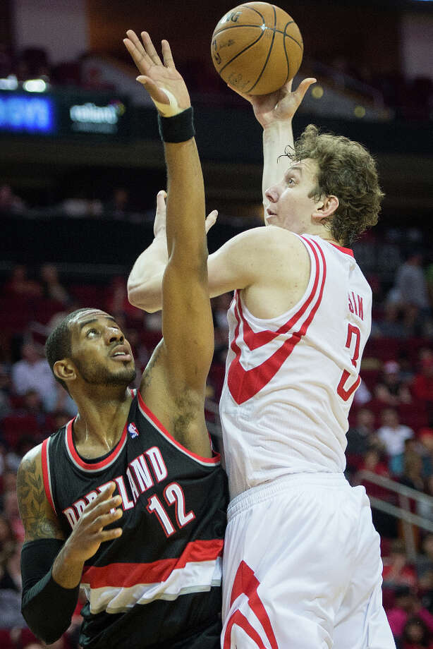 Rockets center Omer Asik (3) shoots over Trail Blazers forward LaMarcus Aldridge. Photo: Smiley N. Pool, Houston Chronicle / © 2013  Houston Chronicle