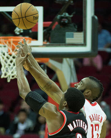 Rockets guard James Harden (13) knocks the ball away from Trail Blazers guard Wesley Matthews. Photo: Smiley N. Pool, Houston Chronicle / © 2013  Houston Chronicle