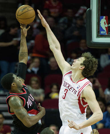 Rockets center Omer Asik (3) blocks a shot by Trail Blazers guard Wesley Matthews. Photo: Smiley N. Pool, Houston Chronicle / © 2013  Houston Chronicle