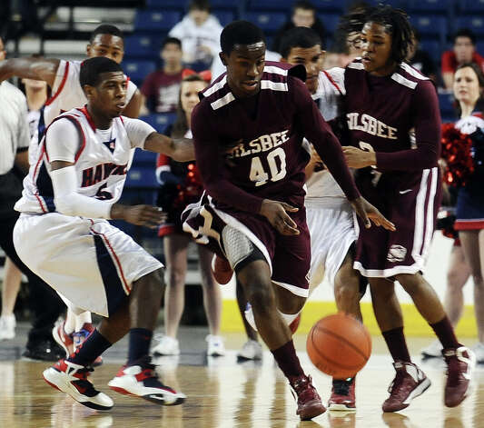 Silsbee player Zayon Jackson, #40, scoops up a loose ball during the Hardin Jefferson High School boys basketball game against Silsbee High School on Friday, February  8, 2013 at Ford Arena. Photo taken: Randy Edwards/The Enterprise