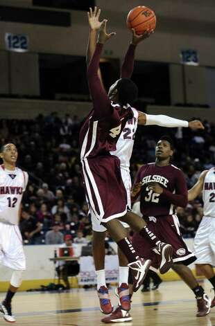 Silsbee player Zayon Jackson, #40, puts it up for two during the Hardin Jefferson High School boys basketball game against Silsbee High School on Friday, February  8, 2013, at Ford Arena. Photo taken: Randy Edwards/The Enterprise Photo: Randy Edwards