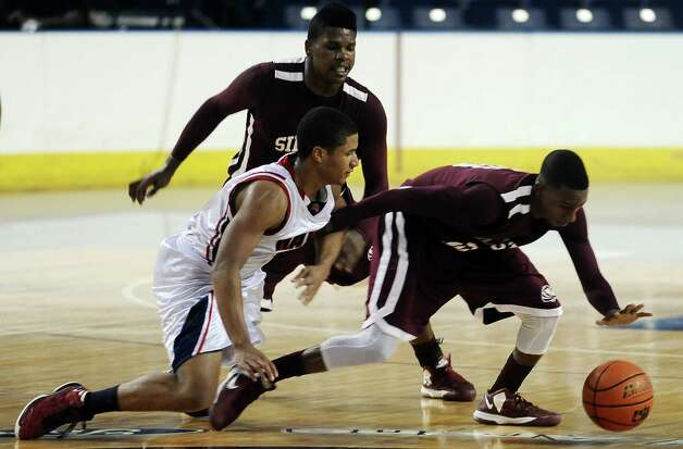 HJ player Travis Stevens, #21, loses pocession of the ball to Silsbee player Chris Elam, #10, during the Hardin Jefferson High School boys basketball game against Silsbee High School on Friday, February  8, 2013. Photo taken: Randy Edwards/The Enterprise Photo: Randy Edwards