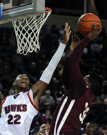 Silsbee player Davaughn Thomas, #32, puts it up for two over HJ player Dylan Mays, #22, during the Hardin Jefferson High School boys basketball game against Silsbee High School on Friday, February  8, 2013 at Ford Arena. Photo taken: Randy Edwards/The Enterprise