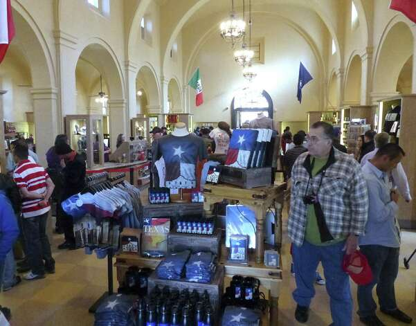 Shoppers browse the gift shop. New offerings include a selection of food products and a counter where home-style Texas fudge will be made.
