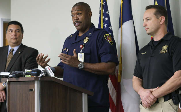 Fire Chief Charles Hood (center) says the Childress Memorial Church of God in Christ fire was not arson. Appearing with him at the Police Department are Crisanto Perez of the ATF (left) and arson investigator Christopher Casals. Photo: Tom Reel / San Antonio Express-News