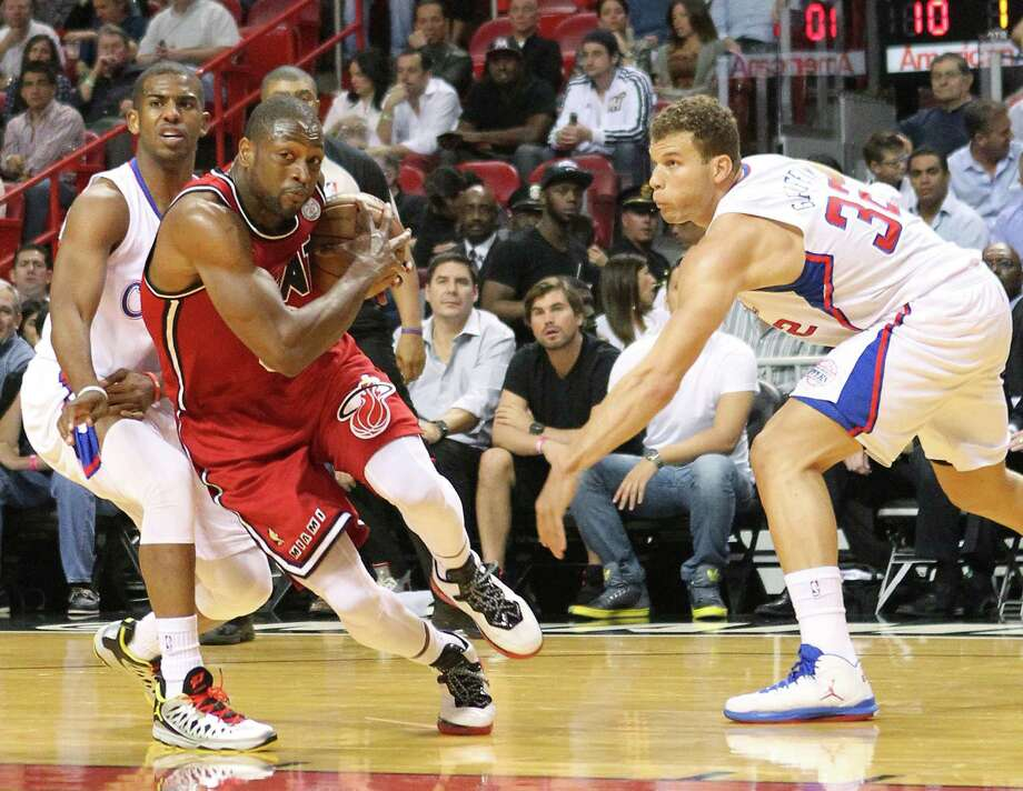The Heat's Dwyane Wade (right) drives past the Clippers' Chris Paul during the first quarter Friday. Wade finished with 20 points in the 111-89 victory. Photo: David Santiago / McClatchy-Tribune News Service
