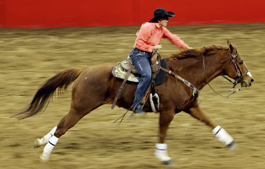 Nancy Hunter, of Neola, Utah, competes in the barrel racing event during the San Antonio Stock Show & Rodeo Friday Feb. 8, 2013 at the AT&T Center. Hunter's time was 14.15 seconds. Photo: Edward A. Ornelas, San Antonio Express-News / © 2013 San Antonio Express-News