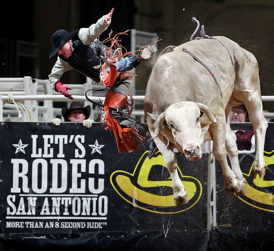 Chris Roundy, of Spanish Fork, UT, is thrown off his bull in the bull riding event during the San Antonio Stock Show & Rodeo Friday Feb. 8, 2013 at the AT&T Center. Photo: Edward A. Ornelas, San Antonio Express-News / © 2013 San Antonio Express-News