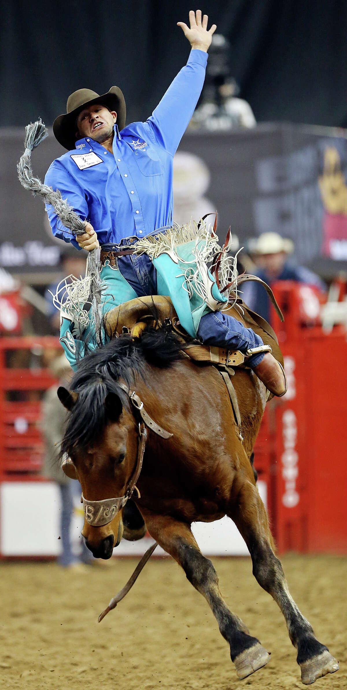 Isaac Diaz, of Desdemona, TX, competes in the saddle bronc riding event during the San Antonio Stock Show & Rodeo Friday Feb. 8, 2013 at the AT&T Center. Diaz scored 78 on the ride.