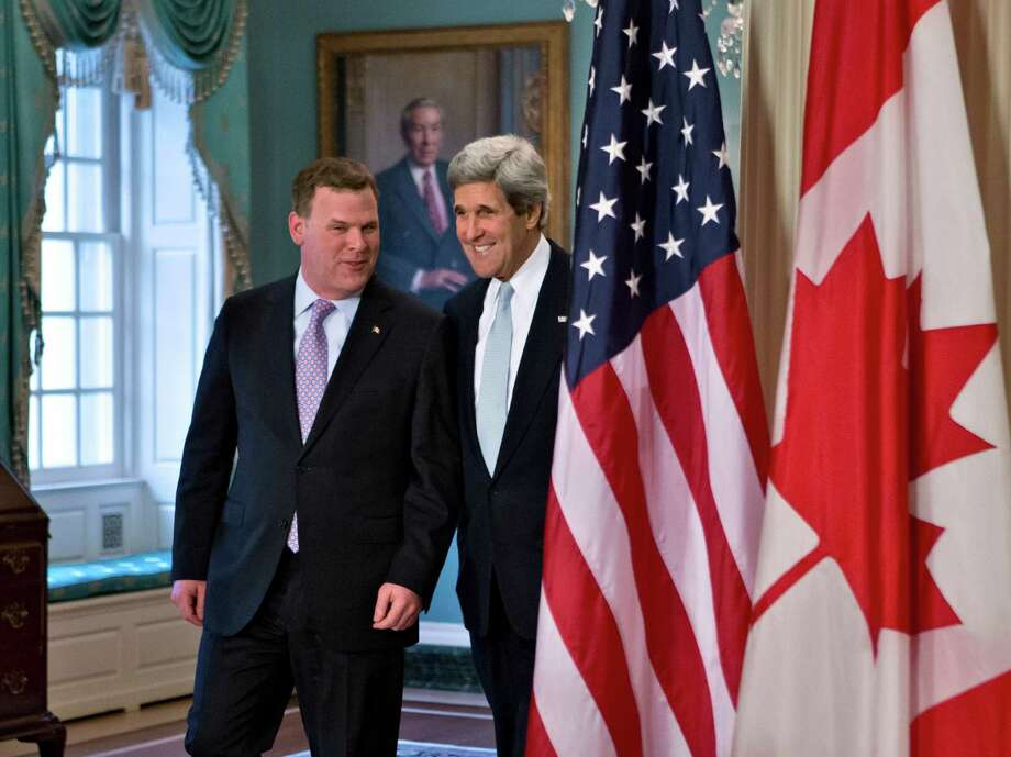 Secretary of State John Kerry, right, and Canadian Foreign Minister John Baird met Friday. Photo: J. Scott Applewhite, STF / AP