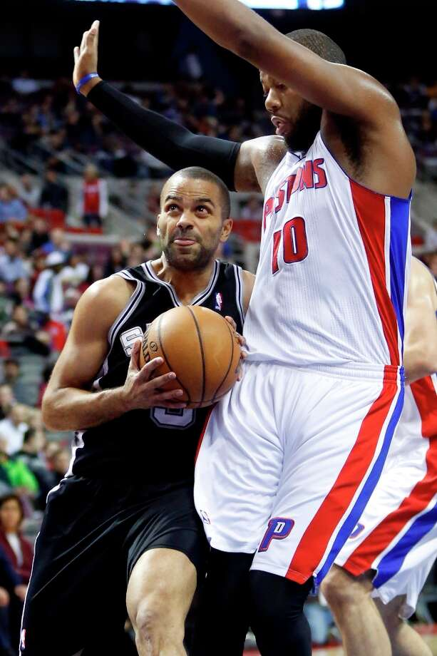 San Antonio Spur guard Tony Parker,left, goes to the basket against Detroit Pistons center Greg Monroe (10) in the first half of an NBA basketball game Friday, Feb. 8, 2013, in Auburn Hills, Mich. (AP Photo/Duane Burleson) Photo: Duane Burleson, Associated Press / FR38952 AP