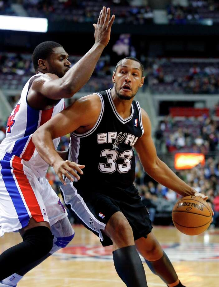 San Antonio Spurs center Boris Diaw (33) drives against Detroit Pistons forward Jason Maxiell, left, in the first half of an NBA basketball game Friday, Feb. 8, 2013, in Auburn Hills, Mich. (AP Photo/Duane Burleson) Photo: Duane Burleson, Associated Press / FR38952 AP