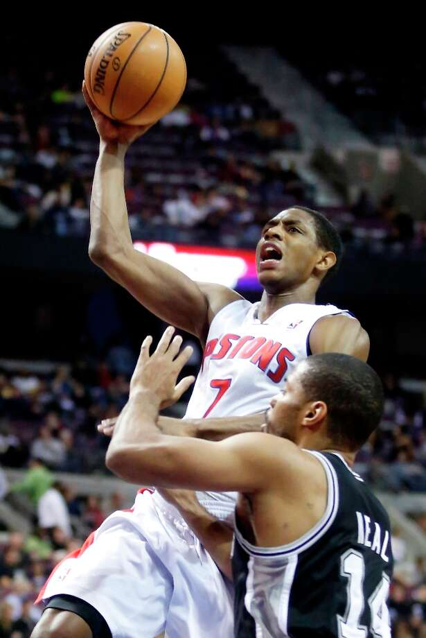 Detroit Pistons guard Brandon Knight (7) goes to the basket against San Antonio Spur guard Gary Neal (14) in the second half of an NBA basketball game Friday, Feb. 8, 2013, in Auburn Hills, Mich. Knight scored 24 points in a 119-109 win. (AP Photo/Duane Burleson) Photo: Duane Burleson, Associated Press / FR38952 AP