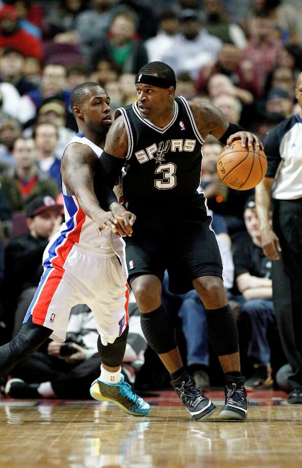 San Antonio Spur forward Stephen Jackson (3) works against Detroit Pistons guard Rodney Stuckey, left, in the second half of an NBA basketball game Friday, Feb. 8, 2013, in Auburn Hills, Mich. (AP Photo/Duane Burleson) Photo: Duane Burleson, Associated Press / FR38952 AP
