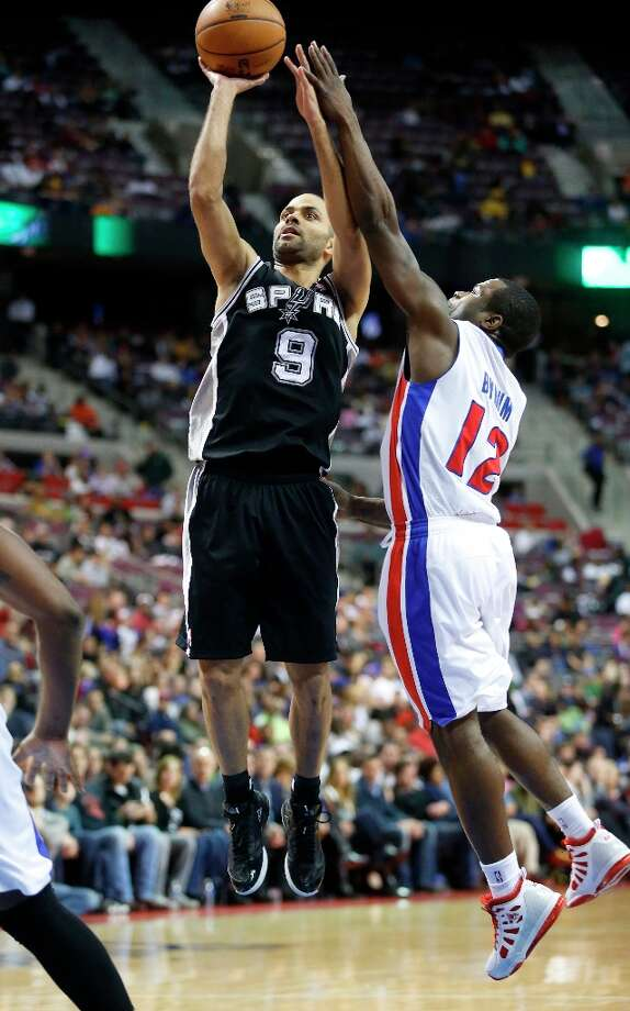 San Antonio Spur guard Tony Parker (9) takes a shot against Detroit Pistons guard Will Bynum (12) in the first half of an NBA basketball game Friday, Feb. 8, 2013, in Auburn Hills, Mich. (AP Photo/Duane Burleson) Photo: Duane Burleson, Associated Press / FR38952 AP