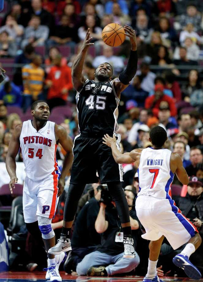 San Antonio Spurs center DeJuan Blair (45) pulls in a rebound over Detroit Pistons forward Jason Maxiell (54) and guard Brandon Knight (7) in the second half of an NBA basketball game Friday, Feb. 8, 2013, in Auburn Hills, Mich. (AP Photo/Duane Burleson) Photo: Duane Burleson, Associated Press / FR38952 AP