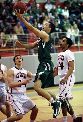 Rattler guard Michael Williams gets to the hoop as Reagan plays Churchill at the Lee High School gym  on February 8, 2013. Photo: Tom Reel, Express-News / ©2012 San Antono Express-News