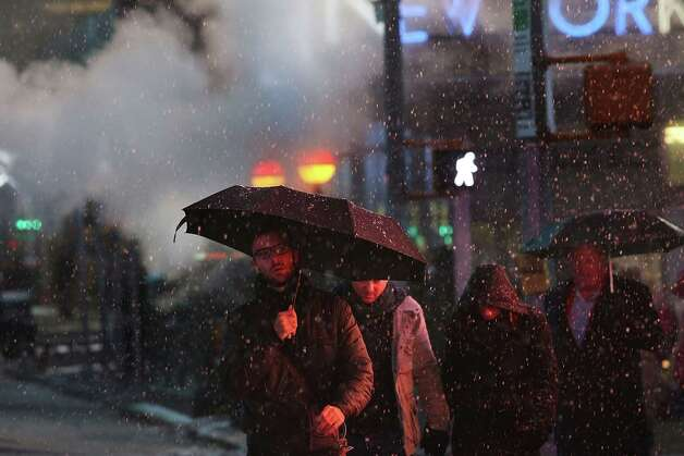 NEW YORK, NY - FEBRUARY 08:  Pedestrians battle wind, snow and sleet as Manhattan experiences a major winter storm on February 8, 2013 in New York City. New York City along with much of the Northeast is expected to get a foot or more of snow through Saturday afternoon with possible record-setting blizzard conditions expected. Heavy snow warnings are in effect from New Jersey through southern Maine. Photo: Spencer Platt, Getty Images / 2013 Getty Images