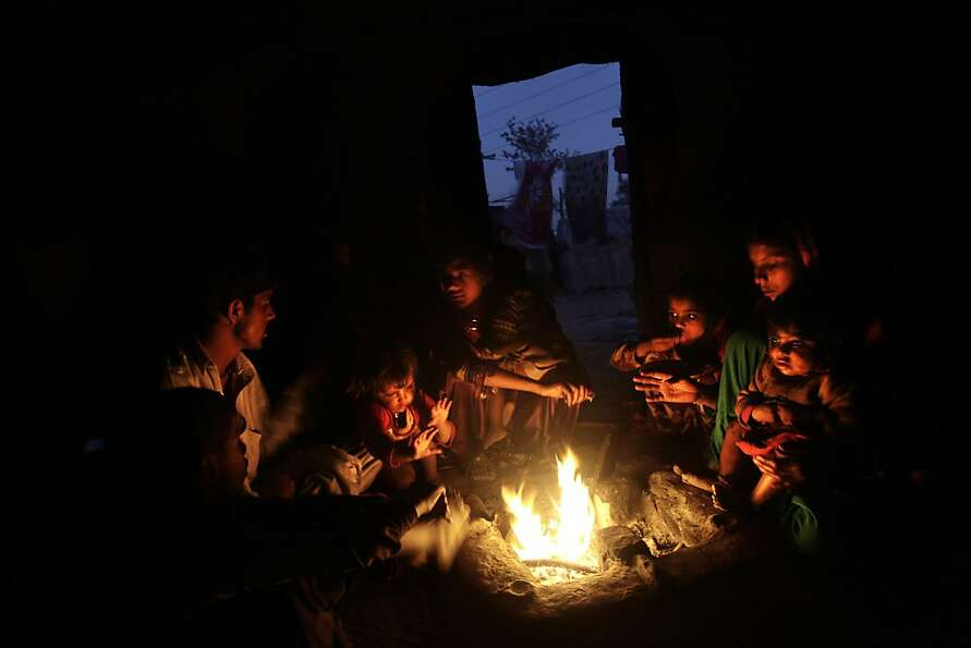A Pakistani family, which was displaced by 2010 floods from a village in Pakistan's Sindh province,